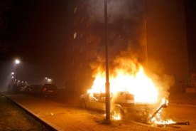 A car burns after being torched during New Year celebrations in Neuhof