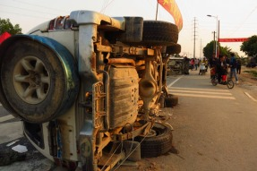 An overturned jeep is seen at the entrance of Shangpu village