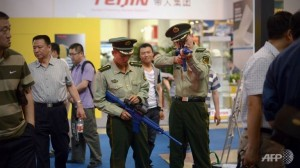 two-chinese-paramilitary-police-test-a-telescopic-sightat-a-police-technology-fair-in-beijing-on-may-15-2013-2