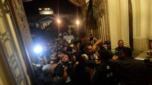 Policemen clash with anti-government demonstrators as they try to occupy the Rio de Janeiro's Municipal Chamber