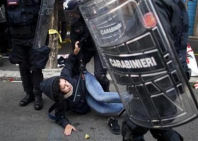 A protester clashes with Carabinieri policemen during a protest in downtown Rome