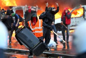 Demonstrators confront riot police during clashes in central Brussels