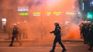 police-officer-smoke-bomb-montreal-protest
